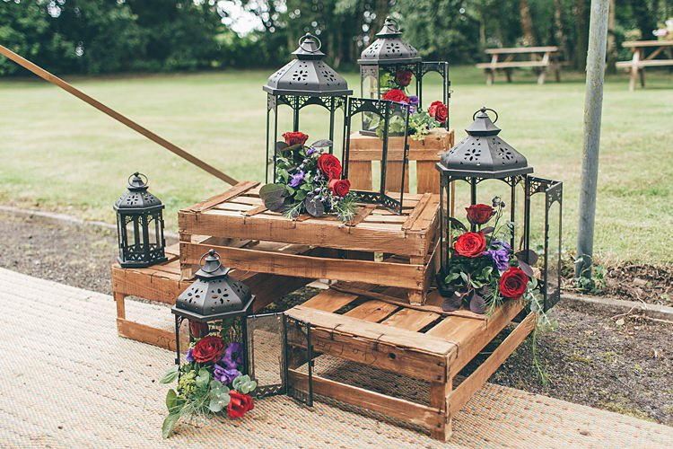 Crates Decor Flowers Lanterns Beautiful Floral Bohemian Garden Wedding http://rachellambertphotography.co.uk/