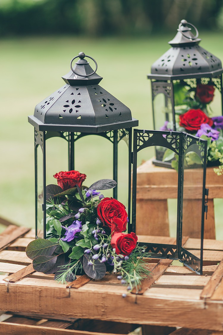 Lanterns Flowers Decor Red Roses Beautiful Floral Bohemian Garden Wedding http://rachellambertphotography.co.uk/