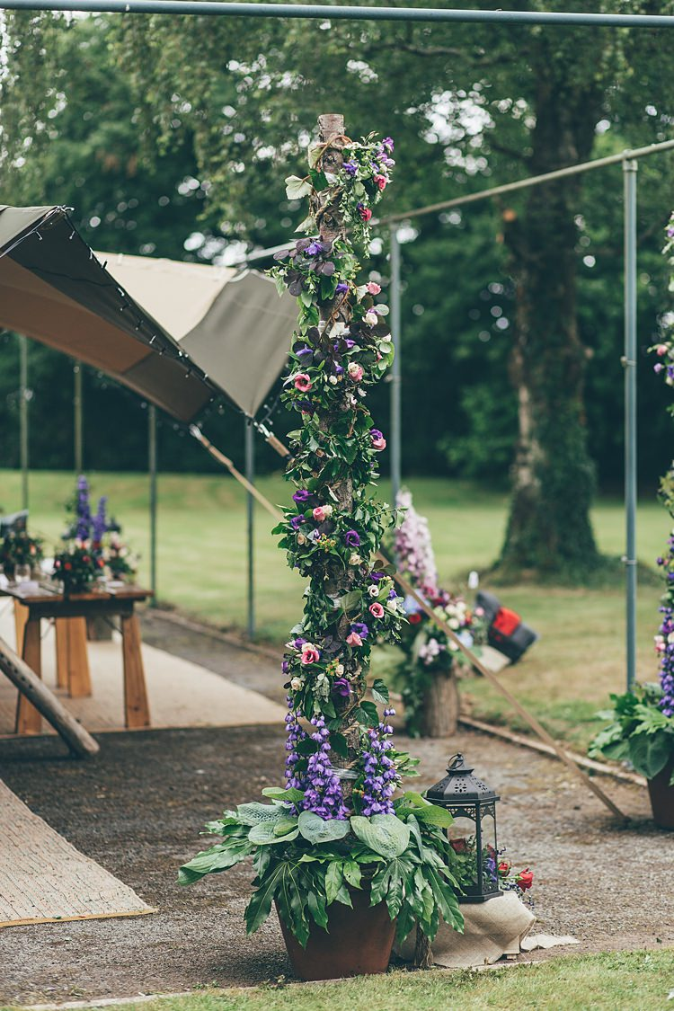 Flower Tree Pole Log Purple Red Pink Beautiful Floral Bohemian Garden Wedding http://rachellambertphotography.co.uk/