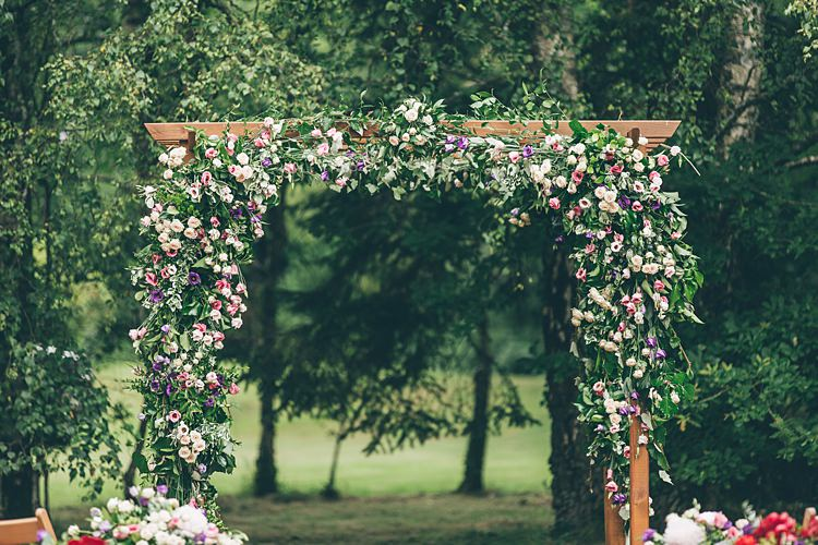 Flower Arch Backdrop Ceremony Beautiful Floral Bohemian Garden Wedding http://rachellambertphotography.co.uk/