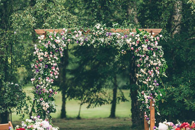 Flower Arch Backdrop Ceremony Beautiful Floral Bohemian Garden Wedding http://rachellambertphotography.co.uk/