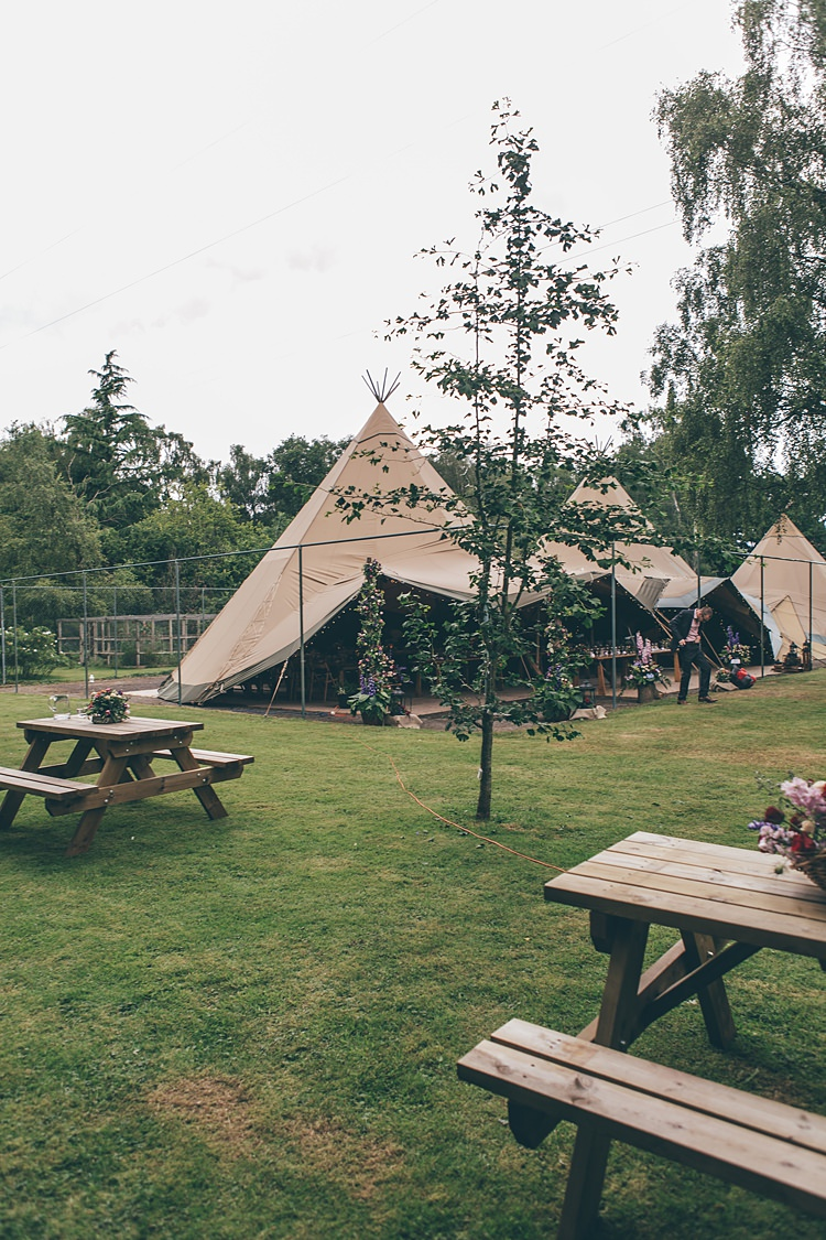 Tipi Outdoor Beautiful Floral Bohemian Garden Wedding http://rachellambertphotography.co.uk/
