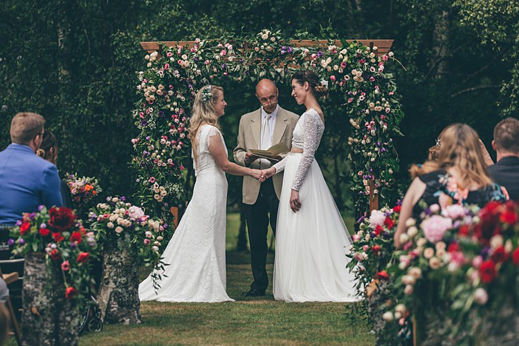 Outdoor Ceremony Flower Arch Backdrop Beautiful Floral Bohemian Garden Wedding http://rachellambertphotography.co.uk/
