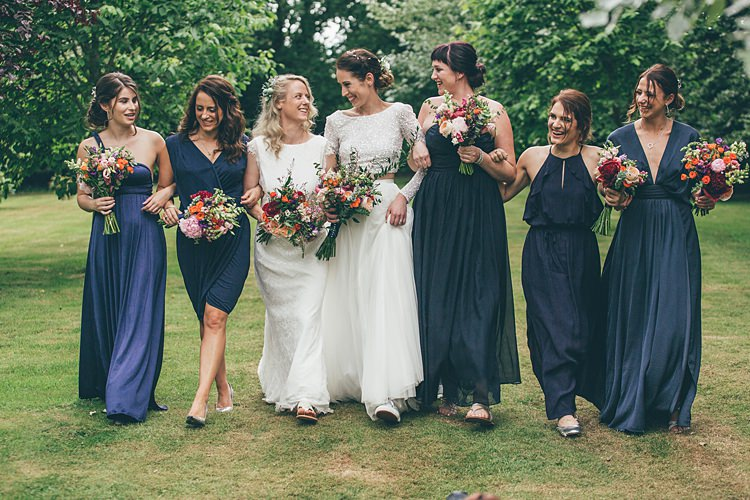 Navy Blue Mismatched Bridesmaid Dresses Beautiful Floral Bohemian Garden Wedding http://rachellambertphotography.co.uk/