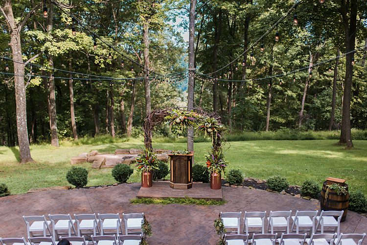 Aisle Ceremony Outdoors Branches Arch Pew Wooden Platform Whimsical Woods Wedding Barn Ohio http://www.connectionphotoblog.com/