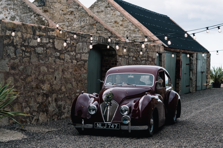 Red Classic Car Transport Twinkling Rustic DIY Barn Wedding https://www.harperscottphoto.com/
