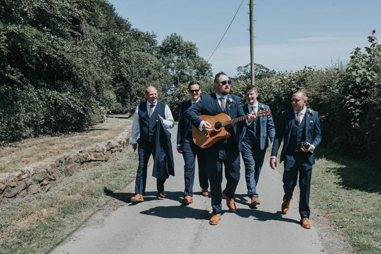 Groom Groomsmen Guitar Herbs Flowers Home Made Walled Garden Wedding https://www.rosiekelly.co.uk/