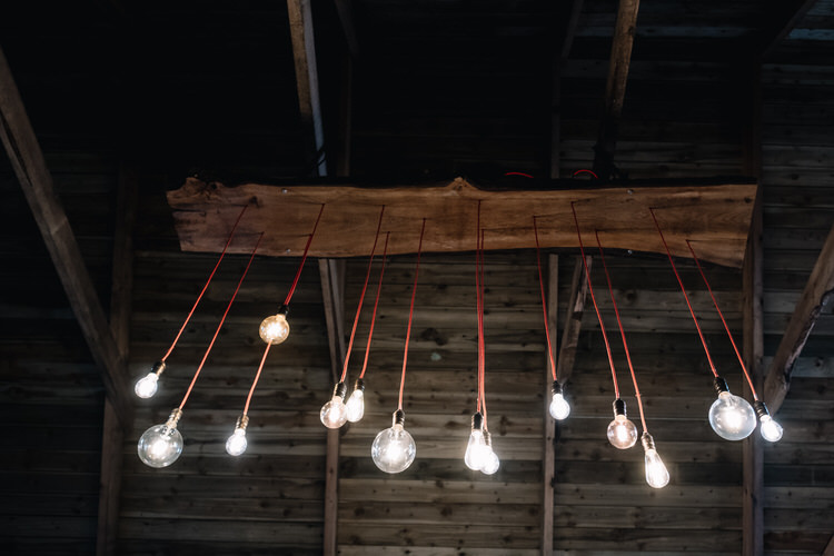 Edison Bulb Lighting Installation Twinkling Rustic DIY Barn Wedding https://www.harperscottphoto.com/