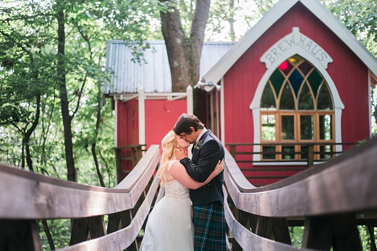 Bride Groom Kiss Bride Tartan Kilt Gown Dress Lace Cap Sleeve Curls Whimsical Woods Wedding Barn Ohio http://www.connectionphotoblog.com/
