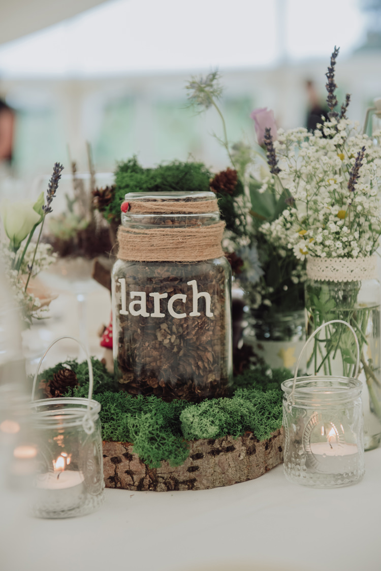 Tree Table Names Centrepieces Jars Moss Pinecones Log Slice Flowers Enchanting Ancient Forest Wedding http://donnamurrayphotography.com/