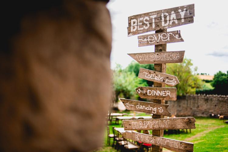 Wooden Sign Post Directions Eclectic Outdoor Barn Wedding https://www.barneywalters.com/