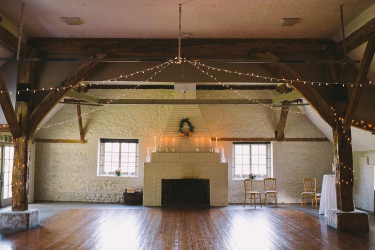 Pea Lights Candles Wreath Fireplace Fairy Lights Vibrant Florals Summer Barn Wedding https://www.oliviajudah.co.uk/
