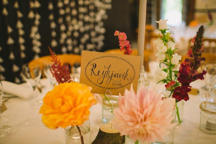 Table Name Modern Calligraphy Jam Jar Flowers Dahlia Stocks Centre Fairy Lights Vibrant Florals Summer Barn Wedding https://www.oliviajudah.co.uk/
