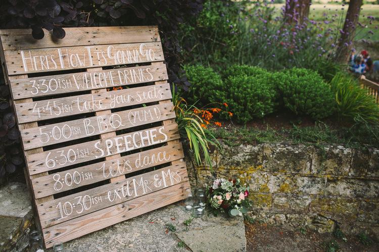 Order of Day Programme Pallet Sign Signage Welcome Fairy Lights Vibrant Florals Summer Barn Wedding https://www.oliviajudah.co.uk/