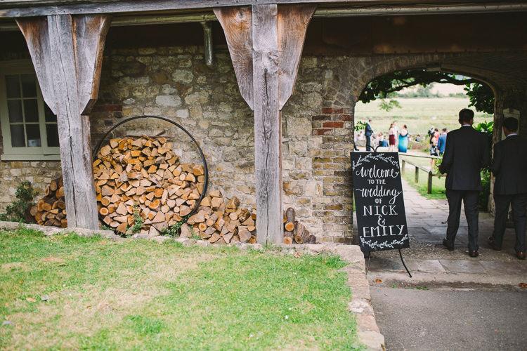 Welcome Sign Chalk Blackboard Modern Calligraphy Easel Signage Fairy Lights Vibrant Florals Summer Barn Wedding https://www.oliviajudah.co.uk/