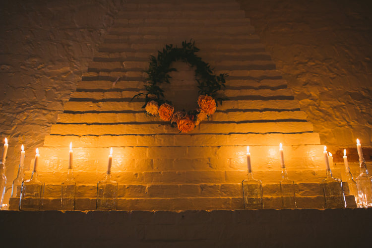 Rose Wreath Candles Fireplace Fairy Lights Vibrant Florals Summer Barn Wedding https://www.oliviajudah.co.uk/