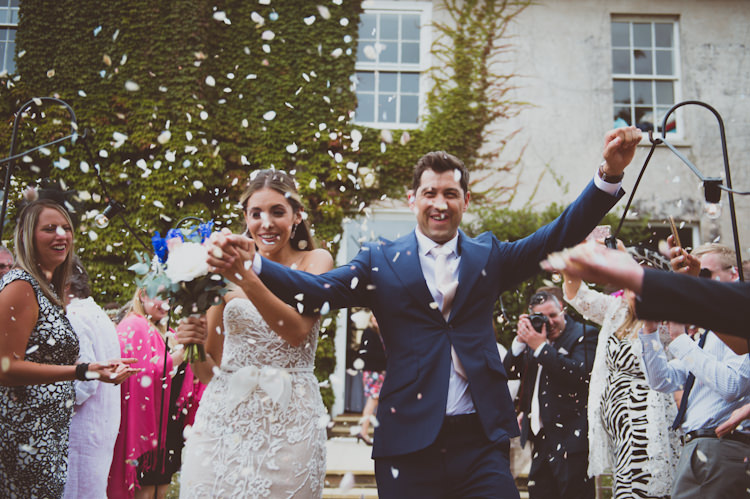 Confetti Throw Bride Groom Stylish Festival Tipi Wedding http://sashaweddings.co.uk/
