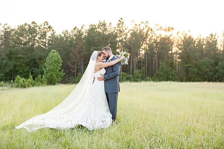 Bride Updo Long Veil Lace Gown Sweetheart Neckline Groom Grey Blue Intimate Farmhouse Wedding South Carolina https://jessicahuntphotography.com/
