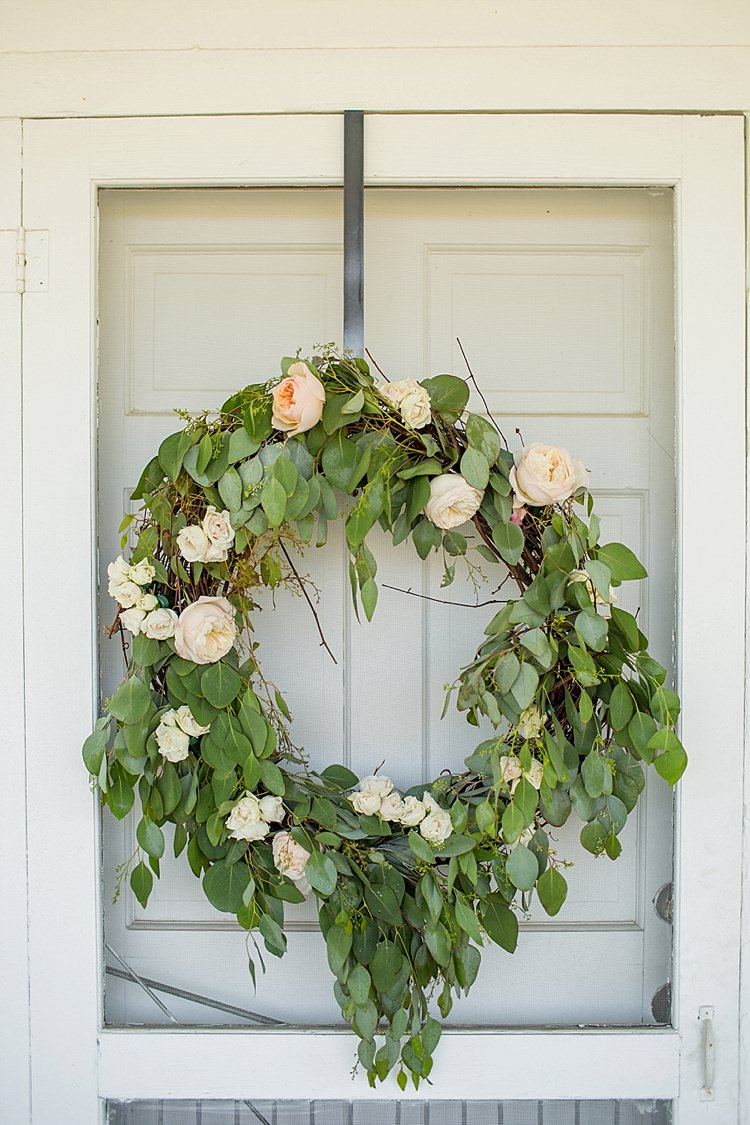Wreath Greenery Roses White Blush Pink Peach Intimate Farmhouse Wedding South Carolina https://jessicahuntphotography.com/