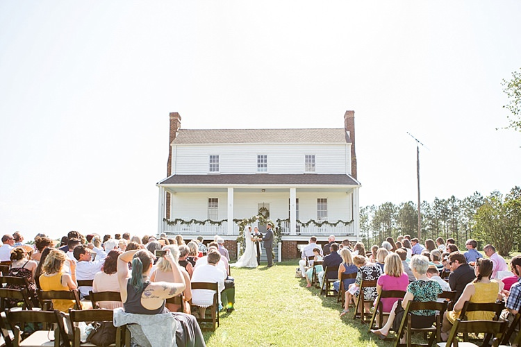 Outdoor Ceremony Guests Greenery Archway Intimate Farmhouse Wedding South Carolina https://jessicahuntphotography.com/