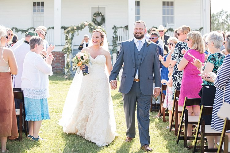 Groom Grey Suit Blue Tie Bride Long Veil Lace Dress Sweetheart Neckline Outdoor Ceremony Archway Greenery Intimate Farmhouse Wedding South Carolina https://jessicahuntphotography.com/
