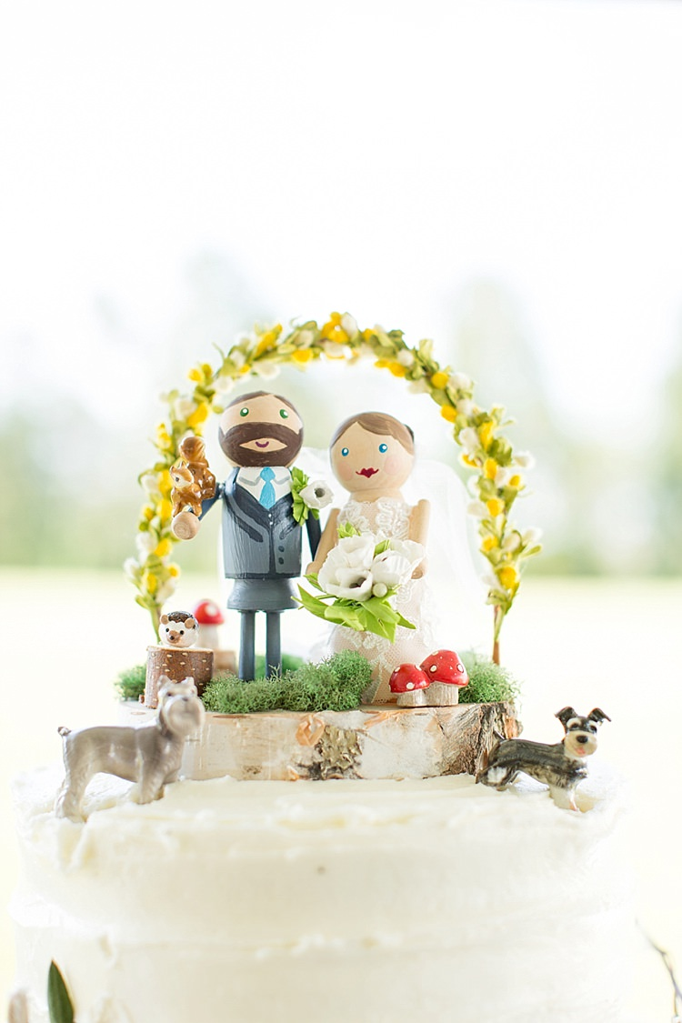 Cake Figurines Topper Pets White Tiers Flowers Greenery Rustic Intimate Farmhouse Wedding South Carolina https://jessicahuntphotography.com/