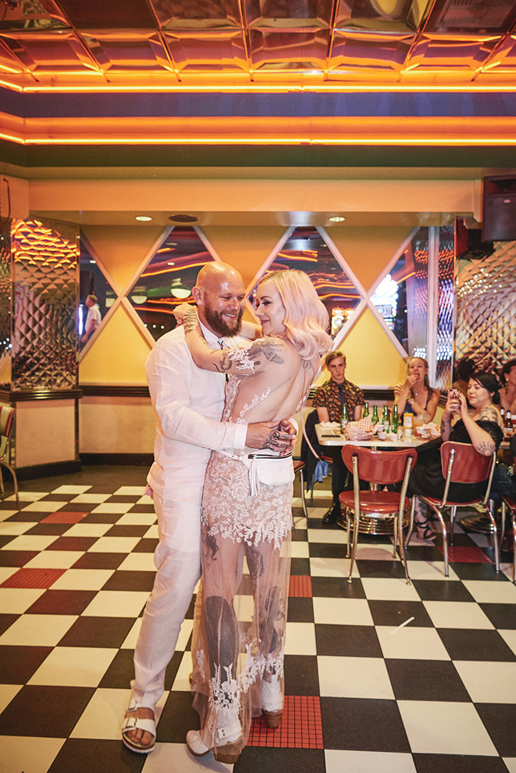 First Dance Diner Bride Pink Hair Blush Sheer Gown Lace Hip Elvis Las Vegas Destination Wedding http://www.roseimages.co.uk/