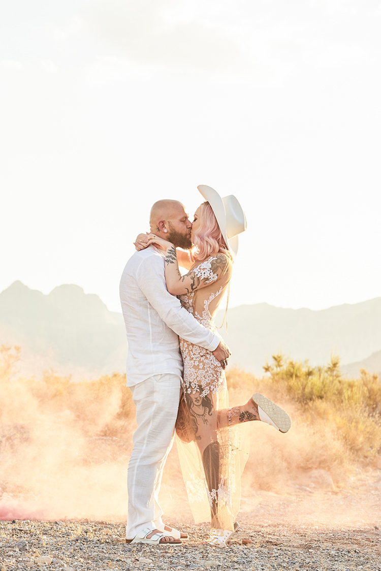 Smoke Desert Groom Cowboy Hat White Bride Pink Hair Blush Gown Lace Sheer Tattoos Hip Elvis Las Vegas Destination Wedding http://www.roseimages.co.uk/