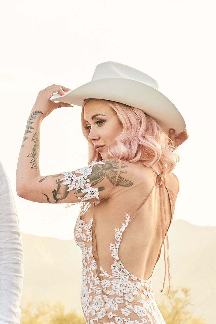 Desert Cowboy Hat White Bride Pink Hair Blush Gown Lace Sheer Tattoos Hip Elvis Las Vegas Destination Wedding http://www.roseimages.co.uk/