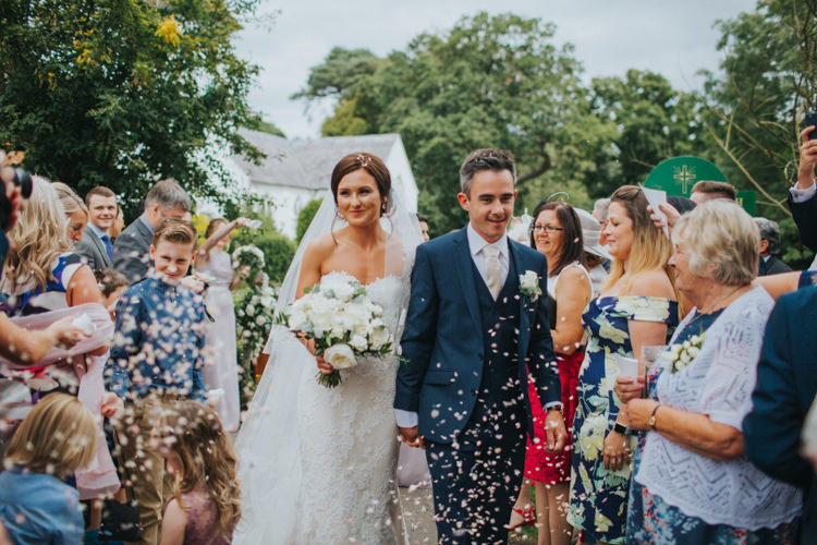 Bride Bridal Pronovias Strapless Sweetheart Fishtail Train Veil White Rose Bouquet Navy Suit Groom Confetti Shot Moment Chic Romantic Florals Candlelight Wedding http://lisawebbphotography.co.uk/