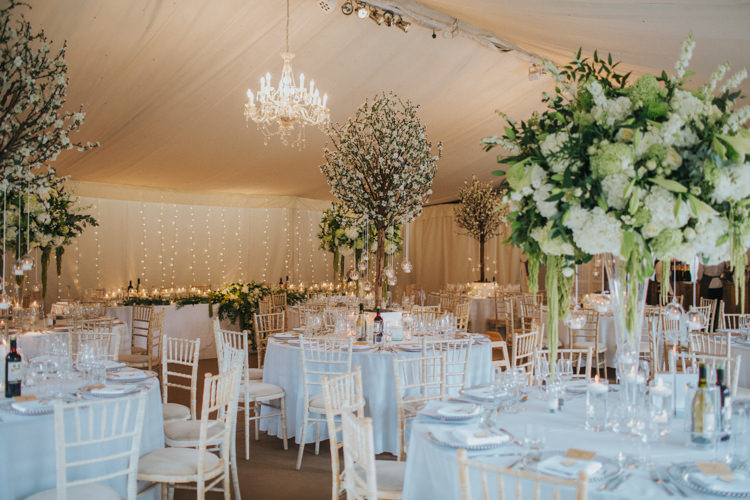 Blossom Trees Tall Centrepiece Table Centre Marquee White Rose Greenery Stocks Chic Romantic Florals Candlelight Wedding http://lisawebbphotography.co.uk/