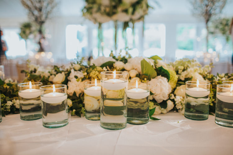 Floating Candles White Rose Greenery Chic Romantic Florals Candlelight Wedding http://lisawebbphotography.co.uk/
