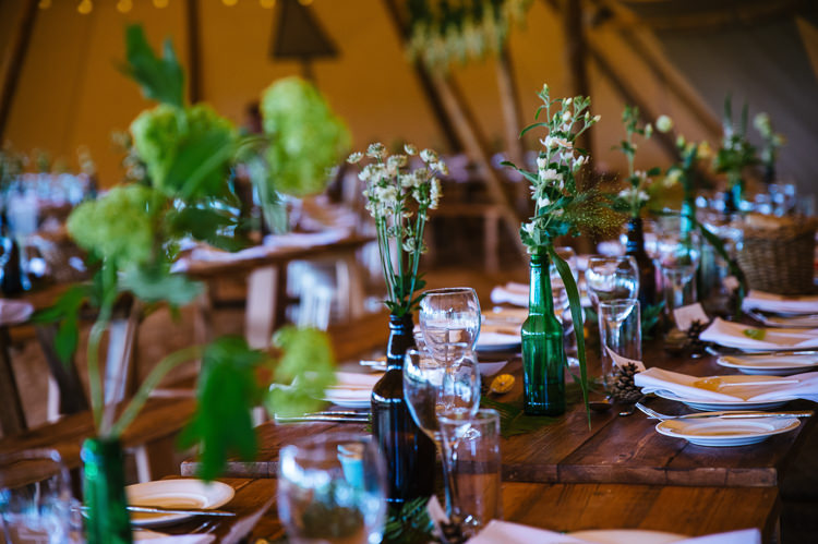 Green Bottle Flowers Foliage Greenery Rustic Tables Magical Woodland Glade Tipi Wedding http://johnnydent.co.uk/
