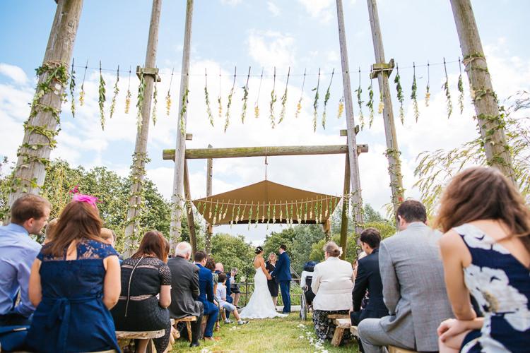 Hanging Flowers Ceremony Backdrop Magical Woodland Glade Tipi Wedding http://johnnydent.co.uk/