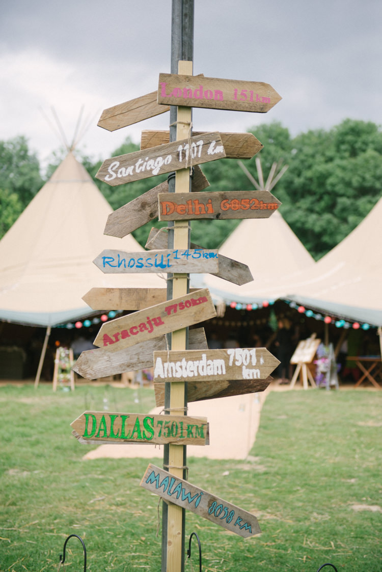Painted Wooden Sign Post Directions Incredibly Pretty Thoughtful Tipi Wedding http://katewatersphotography.com/