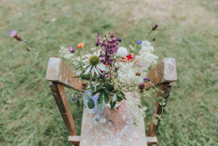 Wooden Ladder Flowers Decor DIY Rustic Incredibly Pretty Thoughtful Tipi Wedding http://katewatersphotography.com/