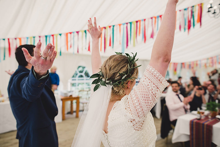 Bride Bridal Lace Guipure Topper Sleeves Dress Gown Veil Greenery Foliage Leaf Crown Entrance Bespoke Navy Groom Multicoloured Streamers Fun Happy Colourful Wedding Vegetable Bouquets https://mylo-photography.co.uk/