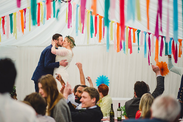 Bride Bridal Lace Guipure Topper Sleeves Dress Gown Veil Greenery Foliage Leaf Crown Bespoke Groom Navy Multicoloured Streamers Marquee Fun Happy Colourful Wedding Vegetable Bouquets https://mylo-photography.co.uk/