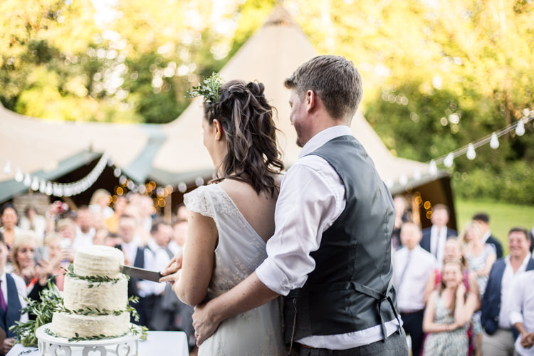 Cake Cutting Buttercream Foliage Greenery Natural Outdoor Tipi Wedding https://www.ad-photography.co.uk/