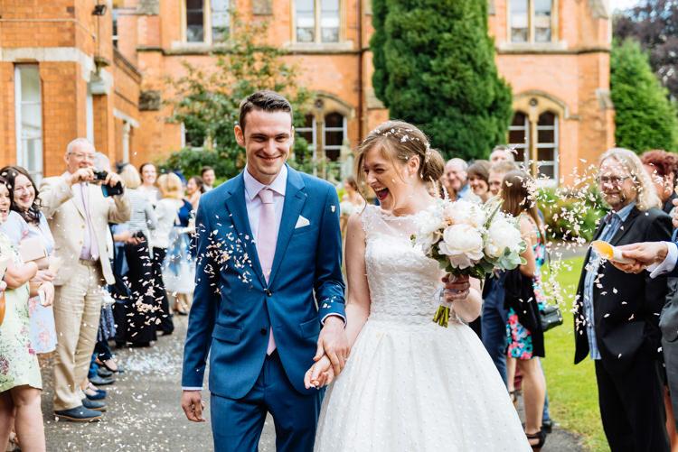 Bride Bridal V Back Ian Stuart Polka Dot Tulle Dress Gown Reiss Groom Airforce Blue Confetti Shot Moment Cute Summer Festival Tipi Wedding http://www.daffodilwaves.co.uk/