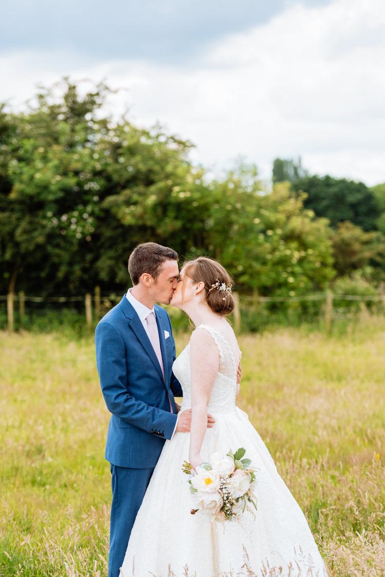 Bride Bridal V Back Ian Stuart Polka Dot Tulle Dress Gown Chignon Hair Piece Reiss Blue Airforce Groom Bouquet Rose Gypsophila Cute Summer Festival Tipi Wedding http://www.daffodilwaves.co.uk/