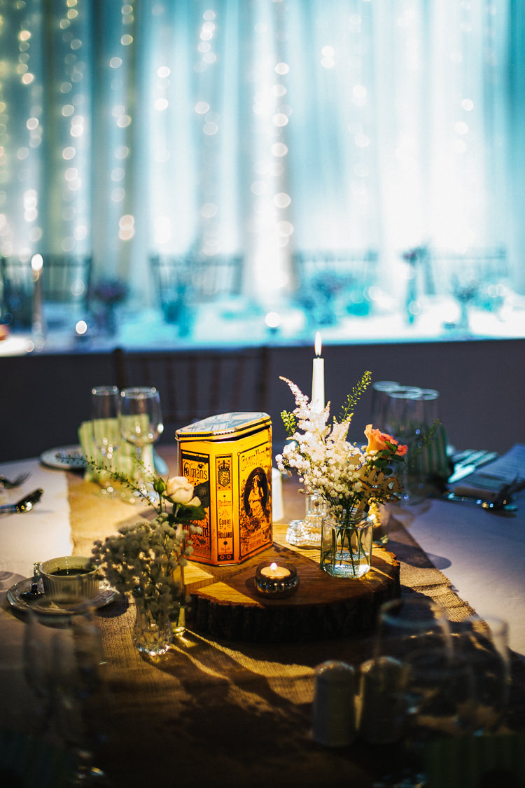 Centrepiece Decor Log Candle Flowers Jar Exquisite Relaxed Rustic Barn Wedding http://www.emiliemay.com/