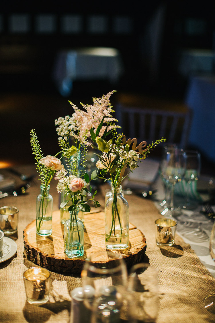 Centrepiece Decor Table Flowers Bottles Jar Log Hessian Exquisite Relaxed Rustic Barn Wedding http://www.emiliemay.com/