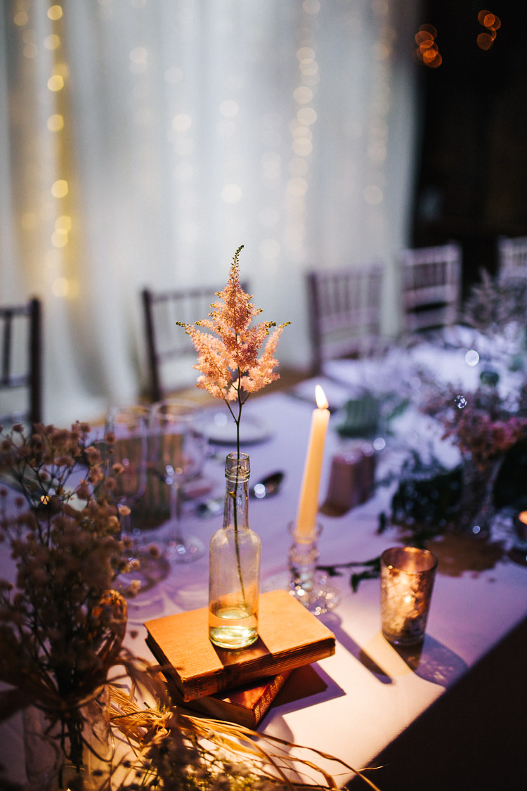 Bottle Flowers Books Candles Astilbe Exquisite Relaxed Rustic Barn Wedding http://www.emiliemay.com/