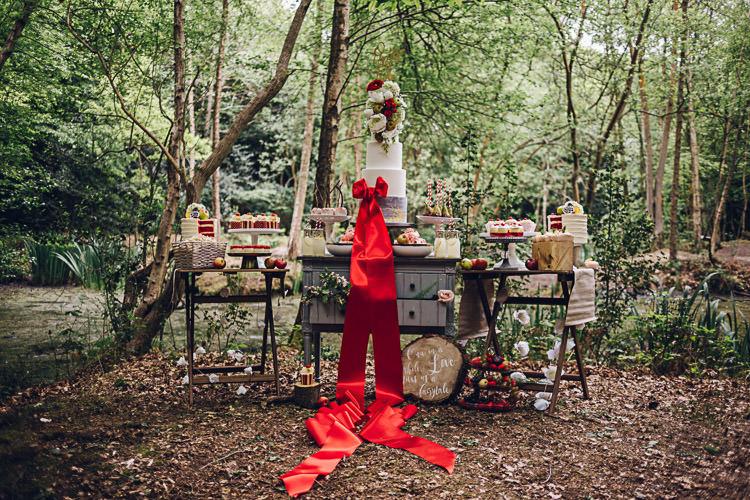 Dessert Table Tall Five Tier Cake Ribbon Red Magical Snow White Woodland Wedding Ideas https://www.chloeleephoto.co.uk/