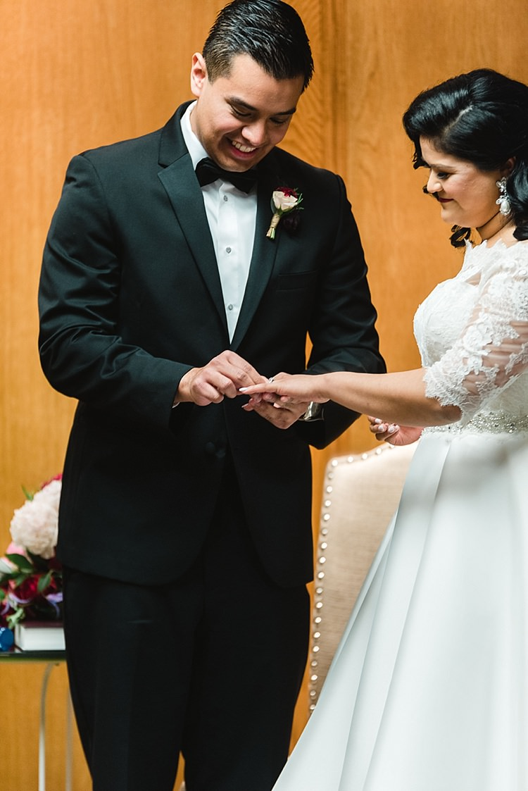 Bride Groom Ring Exchange Vows Dress A Line Lace Sleeves Off Shoulder Bowtie Modern Romantic Winter Wedding Texas http://www.albarosephotography.com/