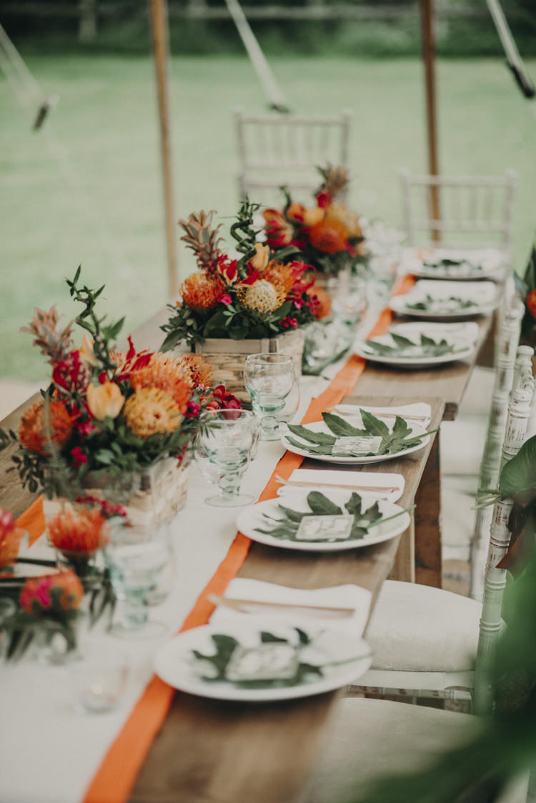 Long Tables Flowers Decor Palm Leaves Tablescape Vibrant Tropical Wedding Ideas http://foto-memories.co.uk/