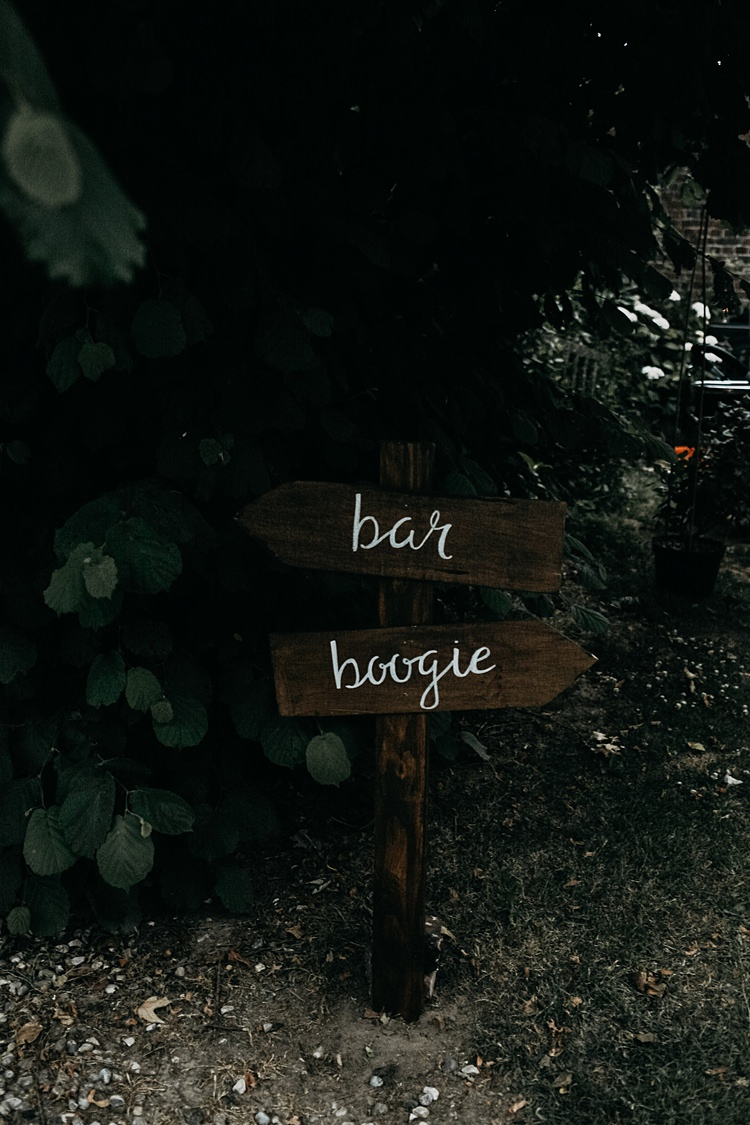 Wooden Painted Sign Post Rustic Greenery Copper Chateau Wedding in France http://hindmari.com/