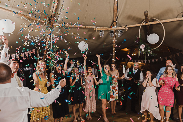 Confetti Cannon Dancing Stylish Woodland Tipi Wedding Flower Arch https://willpatrickweddings.com/