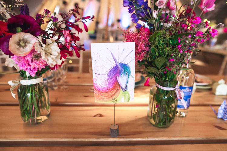 Unicorn Painting Table Name Flowers Decor Outdoorsy Welcoming Colourful Tipi Wedding http://www.sallytphoto.com/